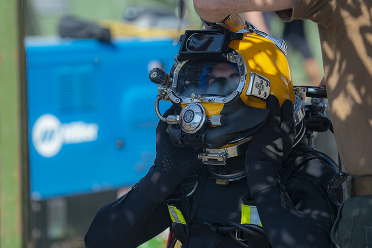 190710-N-LL146-1021 ODESA, Ukraine (July 10, 2019) ¬– A Ukrainian dons the KM37 dive helmet during exercise Sea Breeze 2019, in Odesa, Ukraine, July 10, 2019. Sea Breeze is a U.S. and Ukraine co-hosted multinational maritime exercise held in the Black Sea and is designed to enhance interoperability of participating nations and strengthen maritime security and peace within the region. (U.S. Navy photo by Mass Communication Specialist 1st Class Scott Bigley)